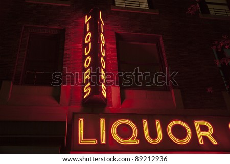 Liquor store neon sign in New York City - stock photo