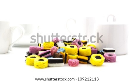 Liquorice allsort sweets in colourful abstract stack design in modern white kitchen setting - stock photo