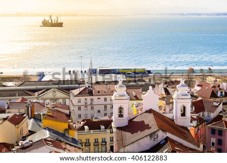 Lisbon coastline with ship at sea at morning - stock photo