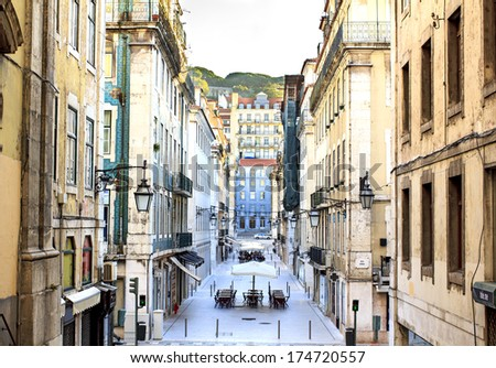 "Lisbon downtown district Baixa - view from the exit of the metro station ""Baixa""  - stock photo"