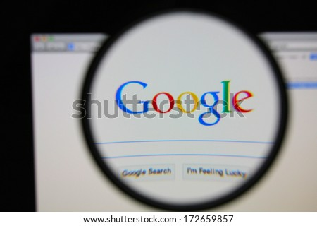 LISBON - JANUARY 22, 2014: Photo of Google homepage on a monitor screen through a magnifying glass. - stock photo