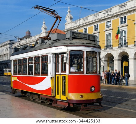 LISBON-NOVEMBER 13, 2015: A typical streetcar (trolley) in Lisbon, Portugal. Although Lisbon has a modern fleet of trams, the old small streetcars remain one of the main tourists attraction - stock photo