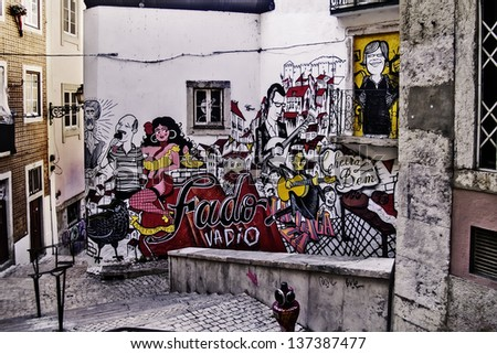 LISBON - NOVEMBER 29: Graffiti symbolizing Lisbon and her traditional music fado, on a wall on downtown on November 29, 2012 in Lisbon. Fado is in the  in the UNESCO Intangible Cultural Heritage Lists - stock photo