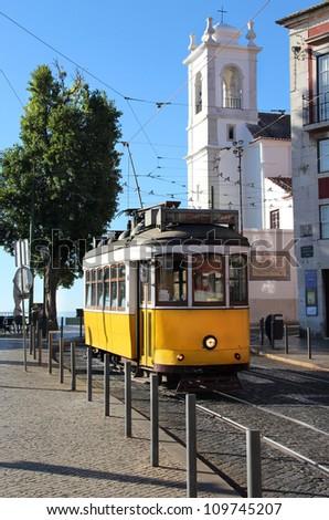 Lisbon old yellow tram - stock photo