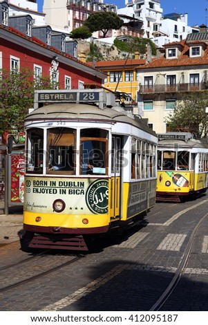 Lisbon, Portugal. April 25, two trams popular with tourists in the suburbs of Lisbon, with focus on leading tram, on April 25 in Lisbon, Portugal. - stock photo