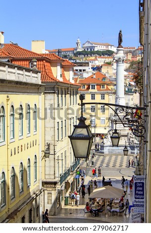 LISBON, PORTUGAL - APRIL 5 : View at the street leading to the Rossio square (or Dom Pedro IV square) - heart of Lisbon on April 5th, 2015 in Lisbon, Portugal. - stock photo