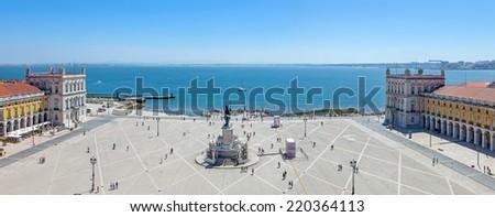 Lisbon, Portugal. August 31, 2014: Praca do Comercio  (Commerce Square) also known as  Terreiro do Paco, with the King Dom Jose statue, the Cais da Colunas (Columns Pier) and the Tagus River estuary - stock photo