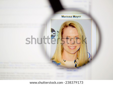 LISBON, PORTUGAL - DECEMBER 16, 2014: Photo of Wikipedia article page about Marissa Mayer on a monitor screen through a magnifying glass.   - stock photo