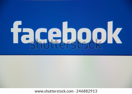 LISBON, PORTUGAL - DECEMBER 30, 2014: View of Facebook homepage on a monitor screen.  - stock photo