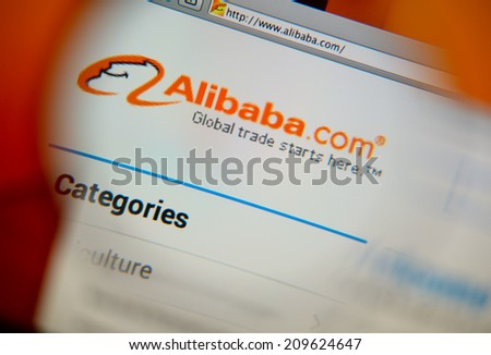 LISBON, PORTUGAL - FEBRUARY 17, 2014: Alibaba homepage on a monitor screen through a magnifying glass.  - stock photo