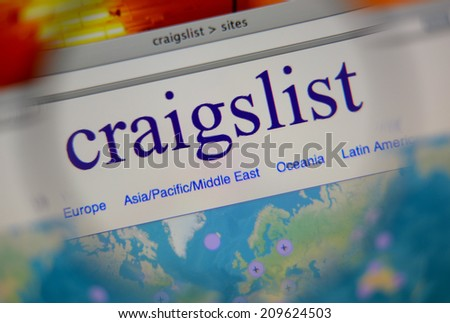 LISBON, PORTUGAL - FEBRUARY 21, 2014: Photo of Craigslist homepage on a monitor screen through a magnifying glass.  - stock photo