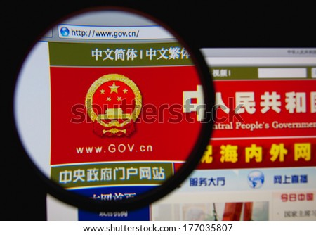 LISBON, PORTUGAL - FEBRUARY 17, 2014: Photo of the Government of China homepage on a monitor screen through a magnifying glass. - stock photo