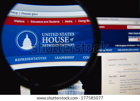 LISBON, PORTUGAL - FEBRUARY 19, 2014: The United States House of Representatives homepage through a magnifying glass. The US House of Representatives is one of the two houses of the US Congress. - stock photo