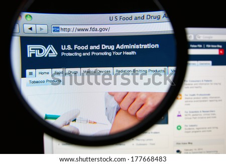 LISBON, PORTUGAL - FEBRUARY 19, 2014: United Sates Food and Drug Administration homepage on a monitor screen through a magnifying glass. FDA is responsible for protecting and promoting public health. - stock photo