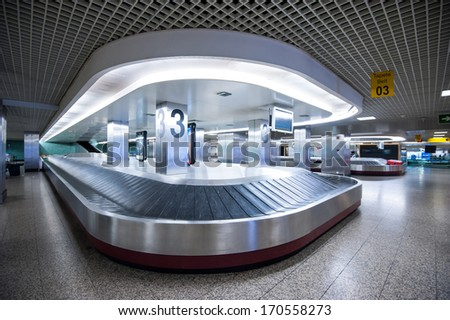 LISBON, PORTUGAL - JANUARY 1, 2014: Conveyor belt in Lisbon airport. Portela Airport is an international airport located in the city of Lisbon, it opened on 1942 and had reached 100,000 passengers. - stock photo