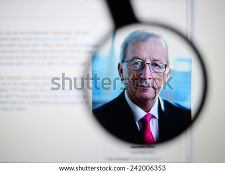LISBON, PORTUGAL - January 4, 2015: Photo of Wikipedia article page about Jean-Claude Juncker on a monitor screen through a magnifying glass.   - stock photo