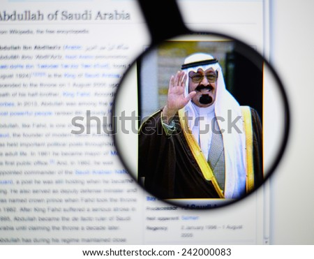 LISBON, PORTUGAL - January 4, 2015: Photo of Wikipedia article page about the Abdullah of Saudi Arabia, Abdullah ibn Abdilaziz on a monitor screen through a magnifying glass.    - stock photo