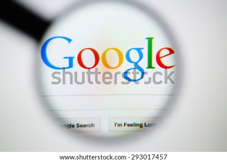 LISBON, PORTUGAL - June 6, 2015. Photo of Google homepage on a monitor screen through a magnifying glass. - stock photo