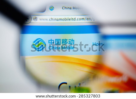 LISBON, PORTUGAL - June 6, 2015: Photo of: www.chinamobileltd.com, China Mobile Limited homepage on a monitor screen through a magnifying glass. - stock photo