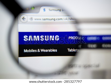 LISBON, PORTUGAL - June 6, 2015: Photo of: www.samsung.com, Samsung  homepage on a monitor screen through a magnifying glass. - stock photo