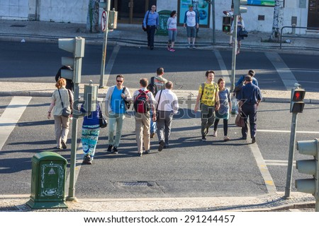 LISBON, PORTUGAL - MAY 24, 2015: A street scene in Lisbon Portugal. Lisbon. With a population of around 2.7 million people Lisbon is the 11thmost populous urban area in the European Union. - stock photo