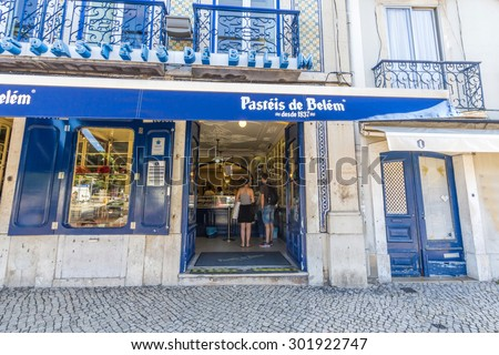 LISBON, PORTUGAL - MAY 26, 2015: The famous Pasteis de Belem, Egg Custard Tart, pastry shop in Lisbon. Over 20.000 tarts are sold daily. - stock photo