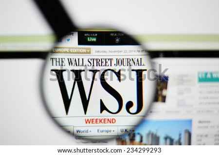 LISBON, PORTUGAL - NOVEMBER 30, 2014: Photo of The Wall Street Journal homepage on a monitor screen through a magnifying glass.    - stock photo