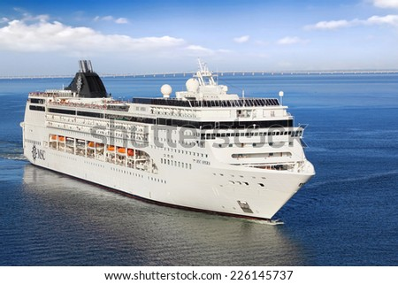 Lisbon, Portugal - October 02, 2014: Cruise Line MSC, cruise ship MSC Opera sails from port Lisbon in Portugal  on October 02, 2014. She can accommodate 2,055 passengers in 856 cabins. - stock photo