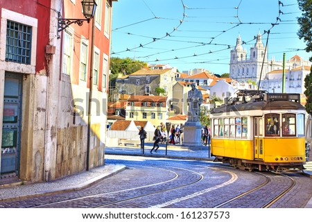 LISBON, PORTUGAL - OCTOBER 30 : Vintage yellow tramway in the city center if Lisbon - one of the main tourist attractions on October 30th 2013 in Lisbon, Portugal - stock photo