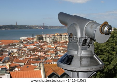Lisbon, Portugal seen from the St. George's Castle with viewing scope - stock photo