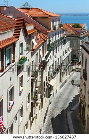 Lisbon street in Alfama district, Portugal - stock photo