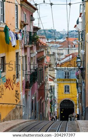 Lisbon street with lift rails - stock photo