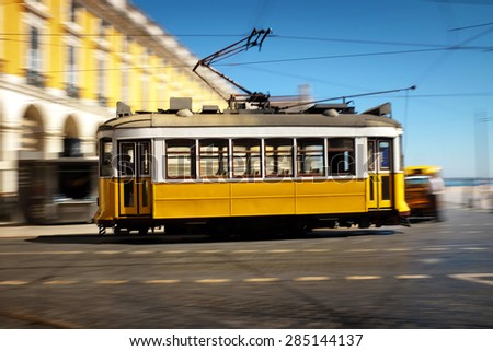 Lisbon traditional old electric tram speeding in Comecio Square - stock photo
