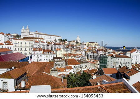 """Lisbon, view on historical district """"Alfama"""" from """"Portas do Sol"""" viewpoint. Portugal.  - stock photo"""