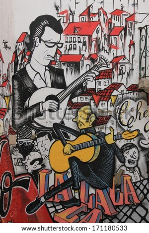Lissabon, Portugal, November 5, 2013. Anonymous graffiti image shows singer traditional portuguese fado. Graffiti is located in old city.  - stock photo