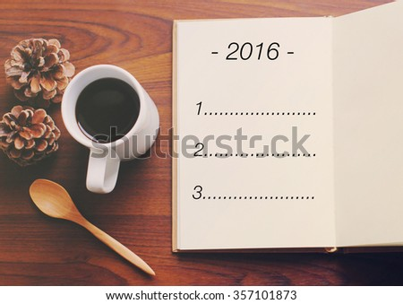 List of goals for 2016 on notebook with cup of coffee  - stock photo