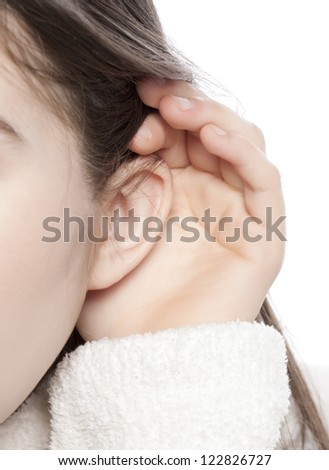 Listening ear of a little child over a white background - stock photo