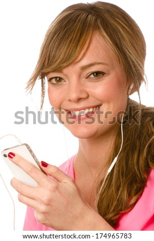 Listening To Music - This is a photo of a cute young woman listening to some music on her ipod. Shot on an isolated white background with a shallow depth of field. - stock photo