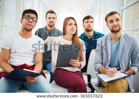 Listening to teacher - stock photo