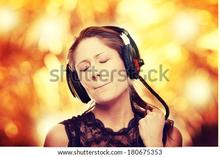 Listening to the Music, young caucasian beautiful woman with headphones, isolated on white background  - stock photo