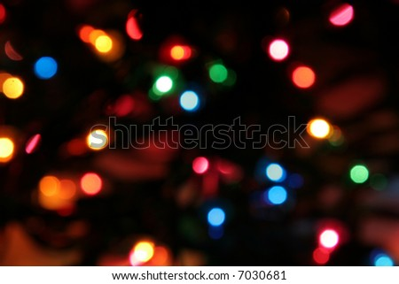 Lit Christmas lights strand deliberately blurred to give an interesting look. - stock photo