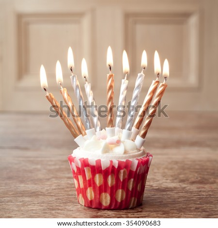 lit cupcake birthday lots of candles - stock photo