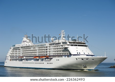 LITHUANIA- AUGUST 25:Cruise liner Seven Seas Voyager in Baltic Sea on August 25,2013 in Lithuania. Seven Seas Voyager is a cruise ship for Regent Seven Seas Cruises.  - stock photo