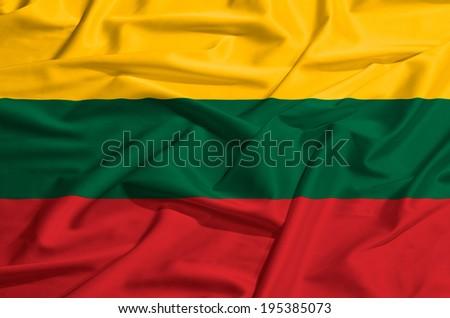 Lithuania flag on a silk drape waving - stock photo