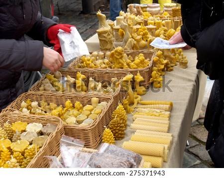 Lithuania. Sale of wax souvenirs at fair of national crafts - Kazyukas - stock photo
