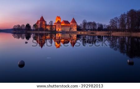 Lithuania, Trakai . Trakai Castle at night - Island castle in Trakai is a museum and a cultural center. - stock photo
