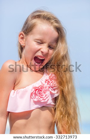 Little adorable girl having fun in outdoor swimming pool - stock photo
