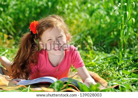 Little adorable girl in field - stock photo