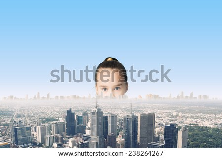 Little adorable looking at city model from under table - stock photo
