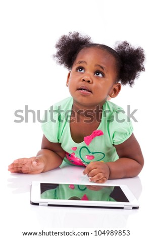 Little african american girl using a tablet  pc, isolated on white background - stock photo
